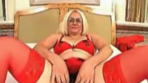 Mature woman wearing red stockings