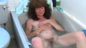 Pretty woman is taking a shower with a sexy woman in the bath tub, all day long