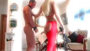 Kinky blonde babe, Rose Red is giving a footjob to her client, while she is kneeling